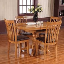 willis round extending dining table and 4 chairs