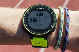 the best gps running watch the sweethome closeup photo of a person wearing a garmin forerunner gps running watch and two bracelets