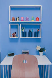 B & Q White Cube Shelves fitted to blue bderoom wall and filled with  Emily's ornaments