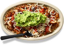 en burrito bowl with guacamole and shredded cheese