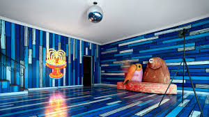 the party room is clad in richard woods s painted wood grain panels sculptures include tim noble and sue webster s wall piece s 2000 and