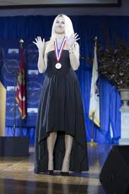 medal of honor given to sandy hook teacher for saving students kaitlin roig debellis receives her ellis island medal of honor on saturday