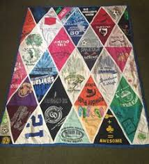 How to Make a T-Shirt Quilt for Beginners a Step-by-Step Guide ... & My Tshirt Quilt with triangle pattern - using favorite tshirts from  elementary to high school # Adamdwight.com