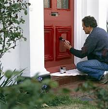 painting front doorA08500075 Painting a front door with bright red paint