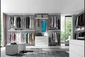 airy interior of glass walk in closet feat high glass windowodern closet storage idea