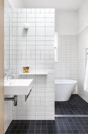bathroom white tiles: bathroom white tile bathroom and bathroom flooring tile with black ceramic floor tile plus floating sink