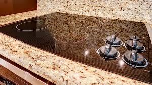 custom stone backsplash behind a kitchen stove in milwaukee