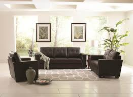 living room black leather couch plus white gray rug on the white tile flooring
