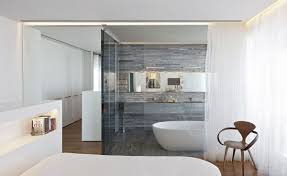 white curtains of glass wall bathtub can be combined with white bathub on the wooden floor