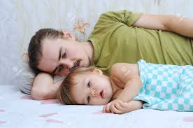 cute baby ailing and lying with daddy sad stock photo 47945073
