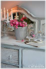 Shabby Chic buffet with music sheets on drawers.