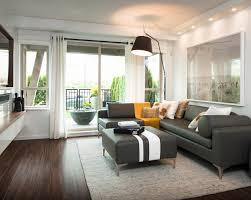 grey leather sofa living room ideas. modern minimalist living room design with black waterproof laminate wood flooring, gray l leather sofa ottoman table, floor lamp, and glass door grey ideas ,