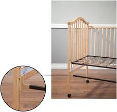 simmons crib parts. picture of recalled crib with location hazard identified simmons parts