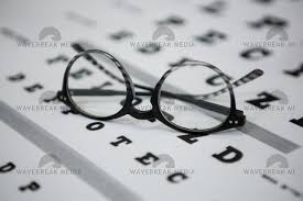 Close Up Of Spectacles On Eye Chart License Download Or