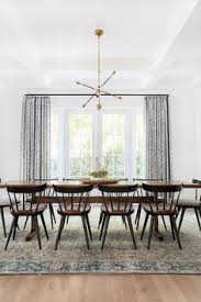 home tour a modern bohemian family abode dining room design dining room rugs dining room table black dining room chairs