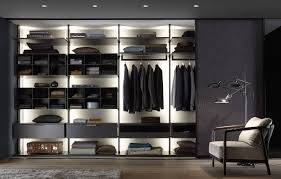 this picture depicts a living room with a shelving system that contains many compartments and offers