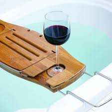features soap holder fold over book support wine glass holder bath ipad holder place for razor and loofah expandable arms and book support slides in