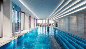 indoor swimming pool lighting. Apartments: Stunning Indoor Swimming Pool With Captivating Lighting