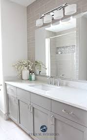 white bathroom cabinets gray walls. bathroom remodel, moen glyde fixtures, bianco drift quartz countertop caesarstone, subway tile wall white cabinets gray walls i