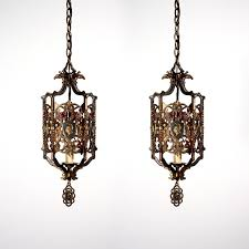 luxurious matching pendant and ceiling lights with two matching antique spanish revival figural bronze