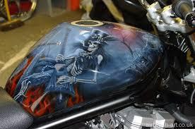 custom paint skull theme on suzuki bandit