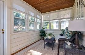 small sunroom. Small Sunroom Addition With Wood Siding And Slat Ceiling