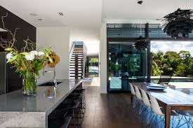 contemporary home lighting design wooden dining table lighting breakfast bar modern house in auckland beach style balcony helius lighting group