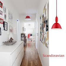 lighting a hallway. red pendant lights add color to a hallway lighting