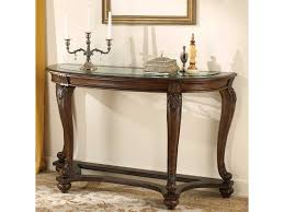 signature design by ashley norcastle sofa table with glass top