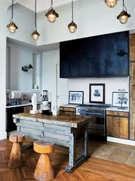 Rustic doors and rustic kitchen island looks great together. Pendant lights  are awesome when they