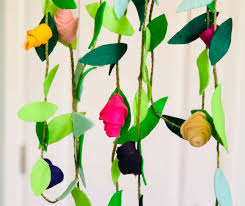 i was ping recently and saw beautiful flower garlands in a window display and i knew what my next project would be this diy felt flower garland is