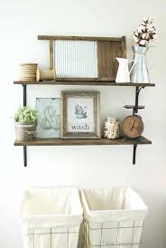 shelves for laundry room wall rustic industrial laundry room shelving idea love those laundry hampers wall