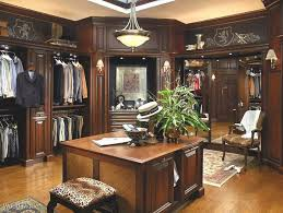 large walk in closet in wood with island