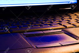Orange Light On Touchpad Laptop Keyboard And Touchpad In Blue And Orange Light