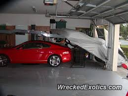 the garage doorShelby Slipped Off The Lift Into The Garage Door While a Bentley