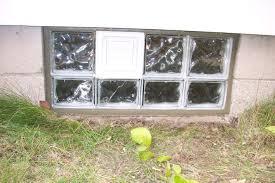 glass block basement window with a dryer vent