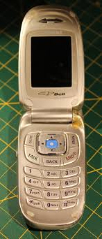 samsung flip phone 2005. here we have a samsung flip phone, even for 2005 this is fairly basic or middle of the road no camera even. phone p