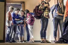 teenagers waiting in high school corridor