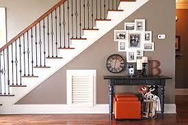 Turn that blank wall under the stairs into a photo gallery wall!