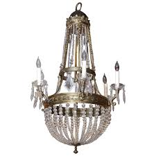 large french empire style bronze and crystal chandelier with six lights for