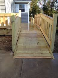 to make for our old girls katie and abby and your old girl scott haha custom treated lumber handicap ramp and railings for the deck