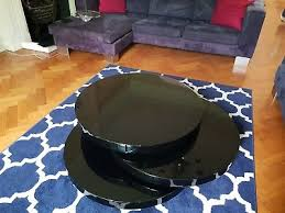 dwell triplo round black gloss lacquer coffee table triple level swivels