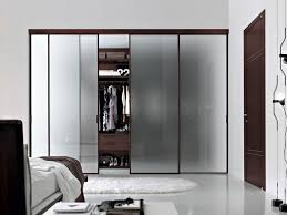 good looking bedroom closet and storage decoration using sliding frosted glass closet door including ikea walk in closet and solid modern cherry wood closet