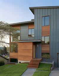 contemporary home exterior materials. modern exterior by deforest architects. more variation in fiber cement panels: vertical board and batten the foreground (note way front door contemporary home materials l