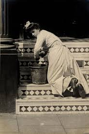 england style steps: cheniston gardens  london  july  a young maid cleaning the steps
