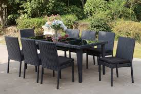 cultivate the mood of a contemporary outdoor dining experience with this clean lined patio table set framed in aluminum and resign wicker