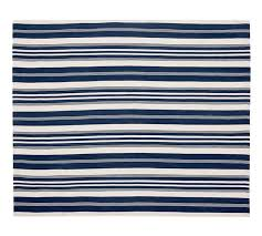 this flat weave stripe rug is made from recycled pet plastic and fully reversible it s also handwoven and yarn dyed the colours should stay vibrant
