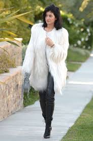 kylie jenner s white faux fur coat by guess