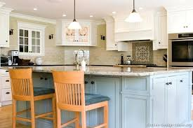 blue and gray kitchen cabinets together with walls plus green