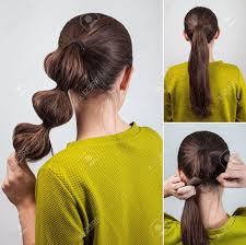 シュシュのチュートリアルで簡単なカジュアルな髪型ポニーテール の写真